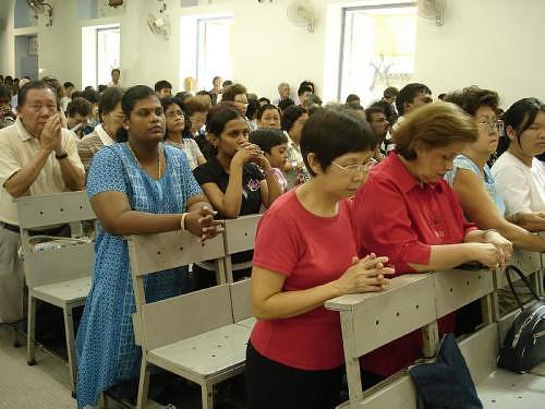 kneeling_at_church